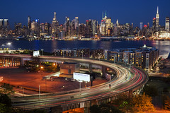 Holland Tunnel Entrance (Brandon Godfrey) Tags: city nyc newyorkcity longexposure trees urban usa ny newyork skyline night newjersey cityscape unitedstates manhattan unitedstatesofamerica nj midtown freeway metropolis hudsonriver empirestatebuilding bluehour chryslerbuilding highrises hollandtunnel weehaken