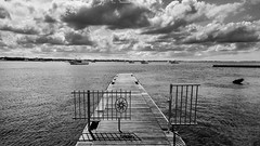 Gate to Summer (Untalented Guy) Tags: sea summer clouds mono monocromo gate mediterraneo nuvole mare estate porto bianco nero salento puglia cancello ionio cesareo