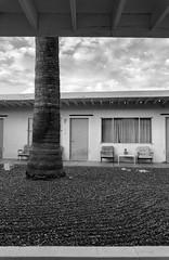 Desert Hot Springs Motel (autobahn66.com) Tags: california sky blackandwhite geometric monochrome clouds fifties desert palmsprings motel minimal springs palmtree zen serene tranquil deserthotsprings monochromia midecenturymodern