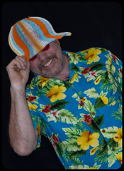 Daft hat and a Hawaiian shirt. (CWhatPhotos) Tags: pictures camera summer sun holiday man silly color colour male colors hat shirt that lens beard fun photography foot prime hawaii goatee glasses cool shoes colours foto bright image artistic time pics pair hula picture hats pic olympus images shades wear ox have mans photographs photograph ii fotos mens hawaiian colored coloured daft which 45mm mk multi contain omd hawai hol hawiian em10 dafty cwhatphotos