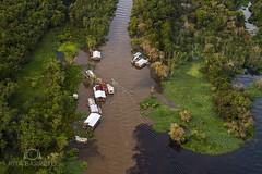 Encontro das guas (Rita Barreto) Tags: rio brasil manaus amazonas rionegro palafitas encontrodasguas riosolimes casasflutuantes nortedobrasil encontrodorionegroeriosolimes