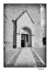 Quick prayer (Artico7) Tags: old blackandwhite bw italy woman church monochrome saint blackwhite ancient san fuji open god stones andrea faith prayer pray entrance andreas christian cobblestones dome sacred portal exit quick biancoenero dore friuli udine venzone sanandrea xe1 saintandreas ciotolato