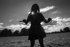 Black woman silhouette (rossellanot) Tags: park sky bw woman sunlight nature grass sunshine silhouette dreadlocks clouds contrast umbrella blackwhite arty sunny blackdress blackwoman