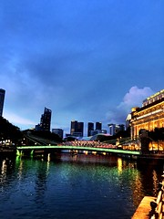 One Fullerton from Raffles Place #onefullerton #rafflesplace #singapore #singaporeriver #evening #bridge #night #twilight #clouds (Swami Stream) Tags: bridge night clouds evening twilight singapore rafflesplace singaporeriver onefullerton