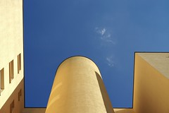 Yellow on Blue (milo J) Tags: blue sky abstract colour building berlin up look yellow architecture germany 50mm apartment outdoor geometry sony a6000