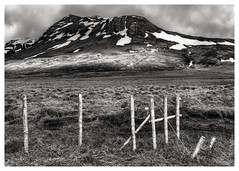 Six Posts and a Hill (John Fÿn Photography) Tags: sky blackandwhite bw cloud 6 sunlight white mountain snow cold west monochrome grass clouds fence landscape grey mono is wooden iceland nikon gray snowing nordic stormysky tundra 2470mm 2470mmf28 manfrottotripod d810 republicoficeland nikkor2470mm constantaperture nikonfx
