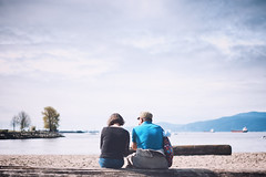 The Couple (Marcel Canfield.) Tags: english bay beach vancouver britishcolumbia canada couple love woman man sea ocean horizon mountains sky clouds resting tired amor casal praia horizonte