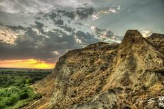 The dark mountain (juangrazz) Tags: sunset sun mountain sol rock clouds atardecer woods paisaje zaragoza bosque nubes montaa hdr roca galacho