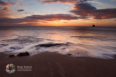 Arrival (Rob Ferrol) Tags: uk cloud sun seascape motion black colour beach sunrise dawn bay coast rocks yorkshire tide horizon north rob coastal whitby drama nab ferrol saltwick