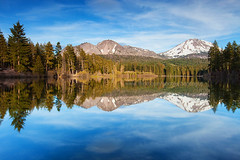 Manzanita Lake (baddoguy) Tags: california ca sunset sky usa lake reflection water evening nationalpark chaos space peaceful peak calm clear crags copy lassen gettyimages manzanita lassenvolcanic vocano 500pxstock gettyimagesstock