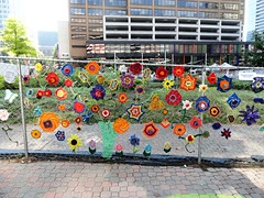 Knittings Decorate Rosslyn, Virginia for Supernova 2013 (lhboudreau) Tags: decorations streets art artist streetperformers performance parks knit rosslyn supernova performers weave performanceartists publicspaces weavings knittings 2013 performanceartfestival rosslynvirginia