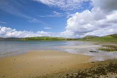 Ettrick Bay, Isle of Bute (Jawad Qasrawi) Tags: blue sea sky seaweed clouds bay scotland sand bluesky pebbles cumulus 7d isle bute ettrick isleofbute ettrickbay bute2013
