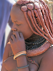 Young Himba girl (young girls and woman who don't have children yet wear this broad necklace) (Linda DV (back, catching up)) Tags: africa street travel portrait people nature face canon river geotagged candid culture clothes ochre ethnic minority namibia himba ethnology southernafrica travelphotography kaokoland travelportrait 2013 geomapped ovahimba minorité minderheid lindadevolder otjikandero otjize powershotsx40