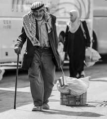"""Get thee out of thy country, and from thy kindred, and from thy father's house"" (ybiberman) Tags: portrait bw man israel box candid jerusalem streetphotography oldman walkingstick ramadan oldcity alquds moslim kafia fridayprayer"