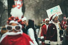 Love at SantaCon (Vitaliy P.) Tags: santa street new york city nyc people love photography nikon kiss kissing couple f14 candid 85mm sigma explore gothamist con d600 nycsantacon explored 2013 jewsforsanta vitaliyp vitaliypiltserphotography