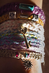 let love shine in (jojoannabanana) Tags: light shadow sun closeup key colorful heart charm bead bracelets wrist braid hemp