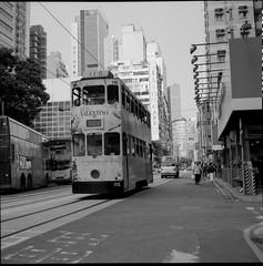 135 (Hoichen) Tags: urban mediumformat hongkong blackwhite tram 120film transportation ilford oldbuilding wanchai xenar f35 75mm rolleicordv delta400pro epsonperfection3200