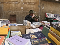 bookseller (Maurizio Targhetta) Tags: city people reading book cityscape reader citylife streetphotography read