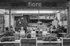 Caffe Fiorentina (Nodding Pig) Tags: uk greatbritain england film caf monochrome 35mm bristol scan hp5 ilford clifton nikonfm2 whiteladiesroad 2015 nikkor50mm caffefiorentina 20151227005101