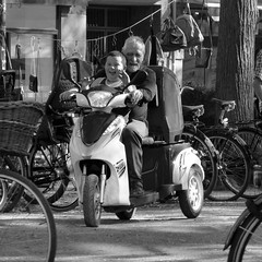 Fun ride...... (tvedepigen) Tags: old city friends summer people urban white black streets men boys smile smiling kids laughing copenhagen children fun scooter