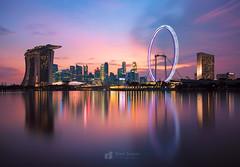 Fine City (Ram Suson Photography) Tags: nightphotography sunset reflection colors skyline marina lowlight singapore cityscape marinabay colorfulreflections singaporeflyer marinabaysands