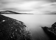 Adopt the pace of nature: her secret is patience -Emerson (Seth GaleWyrick) Tags: olyimpus omd em5 flatheadlake water longexposure 10stop bigstopper nd montana blackandwhite bw monochrome mono wildhorseisland rocks smooth calm west