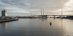 docklands-3854-ps-w (pw-pix) Tags: bridge sky water backlight clouds docks buildings reflections boats lights pier boat cloudy harbour ships towers sunny australia melbourne victoria safety pylon cranes wires walkway wharf docklands ripples poles backlit pillars markers navigation bouys contrejour victoriaharbour boltebridge moored boltebridgepylons formerdockarea