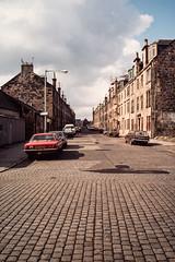 Argyle Street, Paisley (ianrwmccracken) Tags: film 35mm canon buildings lens march scotland 28mm slide flats positive 29 cobbles paisley 1985 argylestreet kodachrome64 fd ae1program
