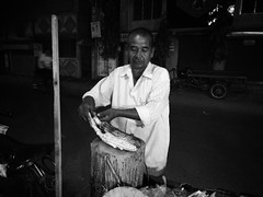 The Corn Seller (arkamitralahiri) Tags: india corn streetphotography streetscene motionblur kolkata maize calcutta shopkeeper belghoria motorolag4plus