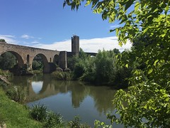 Pont de Besal. (Gerard Gesali) Tags: bridge blue summer sky green holidays colours village pics catalonia catalunya besal