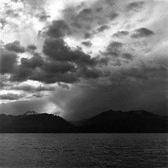 Storm Over The Olympics (bac1967) Tags: blackandwhite bw white storm black mountains tlr water clouds rolleiflex canal kodak tx trix hood kodaktrix olympic developed stormclouds automat olympicmountains rainierbeer hoodcanal blackandwhitefilm caffenol kodaktrixfilm beerenol rolleiflexautomattlr
