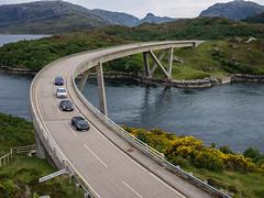 Kylesku Bridge (Bruce Clarke) Tags: bridge cars lumix scotland roadtrip olympus sutherland evo vario m43 kyleskubridge lochachairnbhain lochgleanndubh omdem1 panasonic1235mm northcoast500