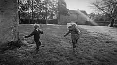 The Adventure Begins (ian.williams040) Tags: candid lepinaylecomte blackandwhite film sonya6000 children france christmas trees people sunny rural sony ultrawideangle