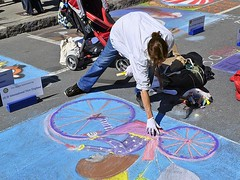 A Skater's Pose (AntyDiluvian) Tags: cambridge woman streetart color art girl bicycle festival boston chalk mural artist drawing massachusetts harvard harvardsquare touchup churchstreet mayfair massave massachusettsavenue streetfestival speedskater chalkonthewalk chalkinthewalk