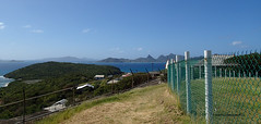 P1080071 (jaglazier) Tags: trees houses panorama plants mountains grass architecture clouds buildings islands landscapes sand seascapes january cities fences villages brush beaches grenadines bushes towns urbanism scrub forests lookouts deciduoustrees 2014 1814 sandybeaches saintvincentandthegrenadines metalfences copyright2014jamesaglazier cambelspath