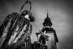 Time and Religion (ch.weidinger) Tags: world street camera city portrait bw white black church statue canon linz lens photography 50mm prime austria sterreich flickr moments foto fotografie time candid religion snapshot creative kirche commons snap best christian explore crop snapshots monochrom moment unposed schwarzweiss zeit decisive 30mm schnappschuss hrsching schnappschsse festbrennweite weidinger 1100d strassenfotografie flickriver