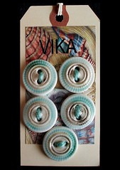 Pie Plate Style (la_v_i_k_a) Tags: ceramic buttons stitcheswest ceramicbuttons vision:text=0543 vision:outdoor=086