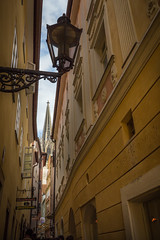 Tight street (GEHPhotos) Tags: street architecture buildings germany streetlight europe streetlamp eu objects cathederal tight regensburg oldtown deu phototype canoneos6d ef2470mmf28usmii