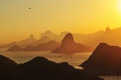 same PLACE at sunset... (Ruby Augusto) Tags: sunset bird airplane hills pôrdosol layers notreatment niteróirj parquedacidaderj morrodaviração silhuetassilhouettes brasilemimagens christtheredeemermonument worldnaturalheritageofhumanity