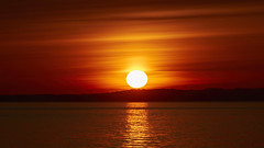 Sunrise (powerdook) Tags: ocean morning red sky orange sun beach water beautiful yellow clouds sunrise bay early