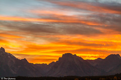 Teton Sunset (Thad Zajdowicz) Tags: grandtetonnationalpark mountains color rugged rocky vivid vibrant landscape americanwest beauty zajdowicz roadtrip 2015 autumn lightroom canon eos 7d dslr digital availablelight handheld awesome outdoor outside sky clouds fire fiery sunset dusk field silhouette