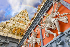Dravidian Architecture Exterior of Hindu Temple (JPLPhotographyPDX) Tags: travel sky sculpture orange india white tourism statue wall architecture standing temple rainbow singapore worship exterior pyramid god cloudy religion knife entrance lord relief sacred symbols shiva hindu hinduism nataraja deity diorama weapons dravidian gopuram eastindian nataraj srisenpagavinayagar tenarms dancingform