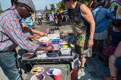 That Color? (stefanws) Tags: california street music art festival oakland hands colorful paint child adult fingers fair lakemerritt pointing henryjkaisercenter