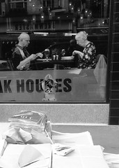 Paper Tigers (bad dancer) Tags: newspapers foreground oldercouple blackandwhitedigitalimage diningincoventgarden