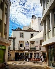 The streets of Faro (Portugal). (Merlijn Scharn) Tags: street streets building portugal clouds buildings shopping faro nikon terrace district stock terraces stilllive stocks bleu shoppingdistrict bleusky streetphotografie d7000