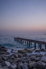 Old rusty pier at the eventing (aleksey_kondratiev) Tags: turkey fethiye oludeniz mediterranean sea water blue wave waves seashore rocks sky sunset pier rust