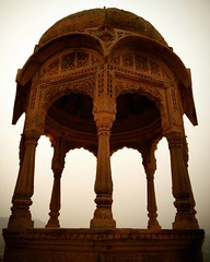 Vyas Chhatri in Jaisalmer. Hand carved and built with locally available yellow sandstone. The distinctive yellowish color of the stone is enhanced by the early morning sunlight, making it appear like gold. Jaisalmer is aptly called the 'Golden City'. ([v]aseem) Tags: square squareformat ludwig iphoneography instagramapp uploaded:by=instagram