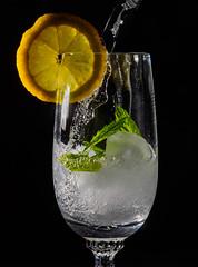 Refreshing Drink (Andreas.Huppert) Tags: ice water glass blackbackground lemon drink mint refreshing sparkling icecube