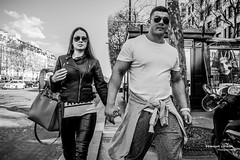 Street - Tough couple (Franois Escriva) Tags: street blue light summer sky bw woman sun white man black paris france green beautiful muscles fashion clouds photo couple pretty noir candid streetphotography handsome olympus nb rue blanc omd