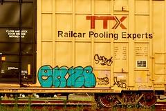 enze (mightyquinninwky) Tags: graffiti indiana railway cargo southernindiana transportation rails spraypaint boxcar railfan evansville ttx railart spraypaintart movingart benched evansvilleindiana enze paintedboxcar